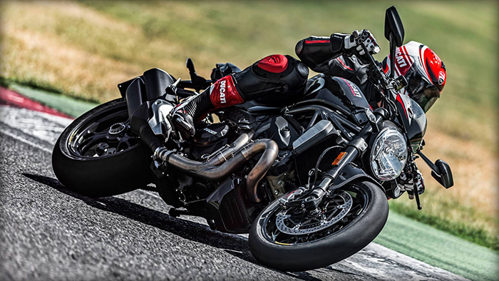Black Ducati Monster 1200 R in action